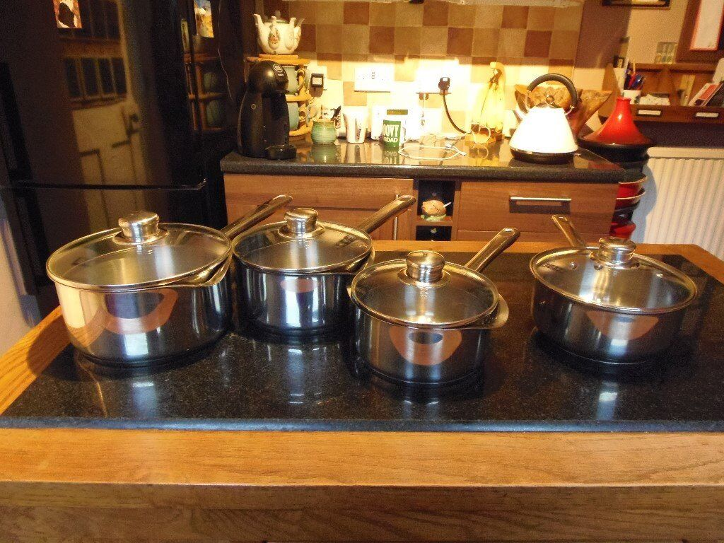 Set of three stainless steel Imperial saucepans and one single stainless steel saucepan