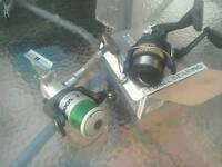 Pair of fishing reels one brand new in box,other one excellent condition