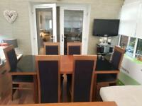 Sterling dining room table with six chairs plus matching sideboard