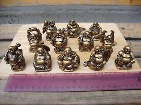 Twelve Little Buddha Figurines.