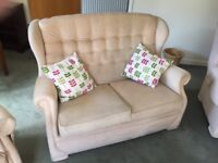 Three piece suite with two chairs and a two seater settee
