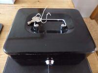 Metal cash box.