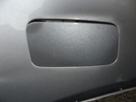 Honda Civic silver drivers side front bumper towing eye cover