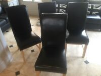 4 Black faux leather light oak legs dining chairs, excellent condition from none smoking house