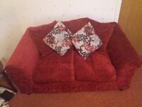 Two seater red sofa, good condition