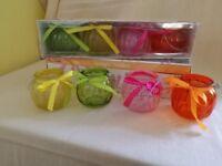 Coloured glass tea light holders