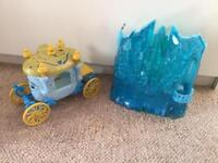 Cinderella carriage and Frozen castle with lights