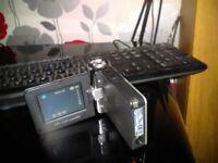 traveller dv 5060 video camera/camera/mp3 player