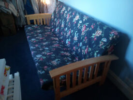 Sofa bed - as new - with two covers - blue floral (as shown) and unused cream cover