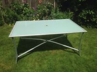 Used glass topped garden table