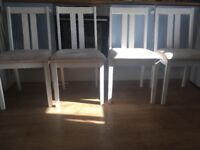 4 white padded seat chairs