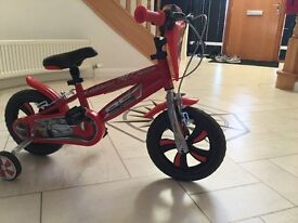 Lightning McQueen red peddle bike with stabilisers