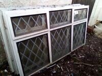 Aluminium windows with leaded light glass