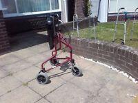 3 wheeled red walking frame
