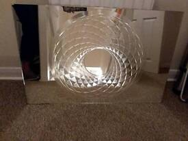 Large mirror with etched spiral design