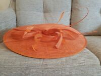Orange fascinator with headband