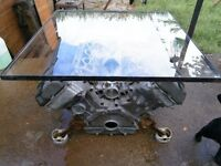 Jaguar V8 engine coffee patio table with safety glass top.