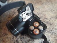 Samsung WB101 digital camera. Complete with case and strap
