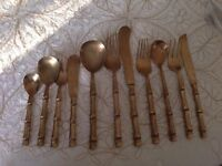 A SELECTION OF BRASS TABLE CUTLERY