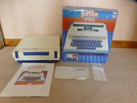 Childs typewriter.PETITE990.Excellent condition. Like new.In original box ,full colour instructions.