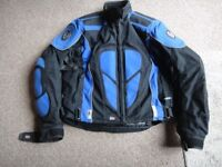 Belstaff motorbike jacket with lining size medium used but still in good condition