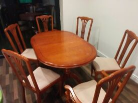 Extendable dining table + 6 chairs