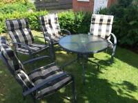 Glass top table and matching chairs for sale