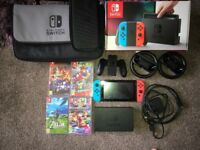 Nintendo Switch Neon Console with 4 top games and carry cases