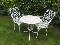 Cast iron garden furniture table two chairs