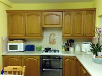 Superb wood effect kitchen with oven and hob