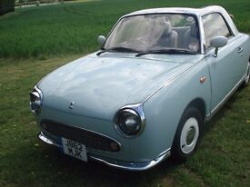 Blue/White Nisan Figaro convertible, automatic, full leather upholstery, air conditioning