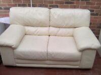 X2 cream leather sofas excellent condition £50
