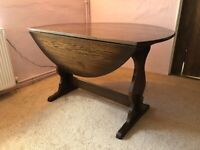 Dark wood drop leaf dining table and 4 chairs