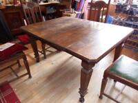 Antique oak table and six chairs