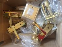 5 brass Door handles and 2 chrome handles with matching light switch