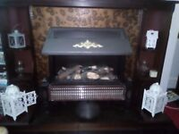 Electric fire and wooden surround