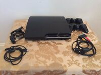 Playstation 3 Slim console, with x2 controllers and 13 games included