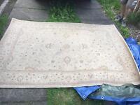 Beige/light brown rug