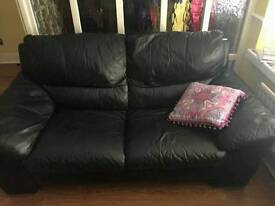 Two 3 seater black leather sofas