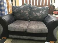 Black fabric 2 seater can deliver