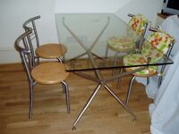 Glass-top Table and 4 Chairs with Seat Pads