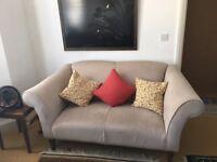 Cream made dot com 2-seater sofa in good condition