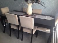 Black Dalton Table and 6 chairs.