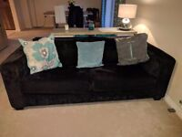 Black fabric 3 seater 2 cushion sofa. Collection only.