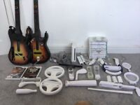 Wii console comes with two guitars two remotes