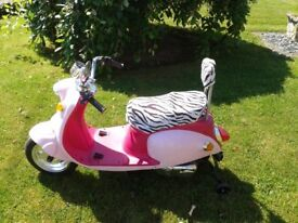 Childs Ride On Scooter, pink, complete with battery charger.