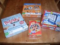 Four family board games.
