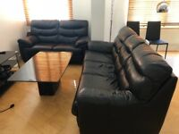 DFS black leather two seater sofa and reclining armchair. Great condition - pickup ASAP E1 7NA