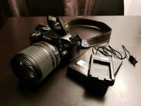 Nikon D5100 DSLR camera with official Nikon 18-105mm lens excellent condition.