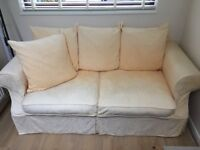 A two seater cream sofa. No damage, used condition. Extremely comfortable. Free on collection.